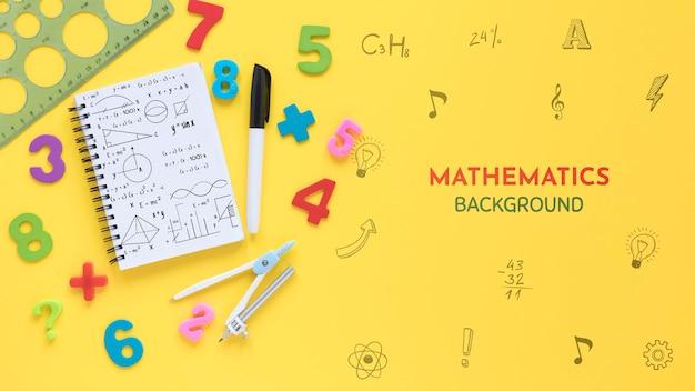 Vista superior del fondo de matemáticas con cuaderno y números PSD gratuito