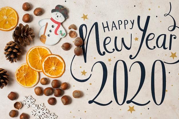 Vista superior de la maqueta de feliz año nuevo 2020 PSD gratuito