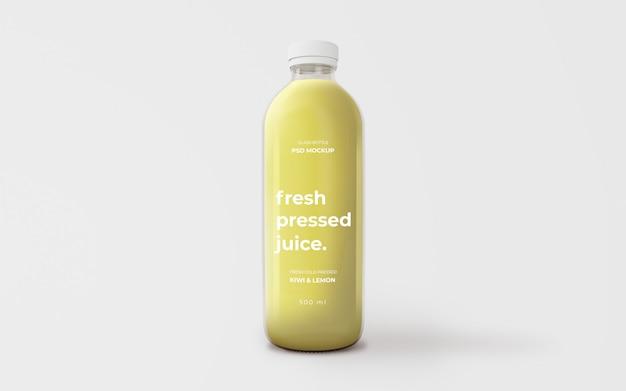 Volledig bewerkbare mockup met glazen fles met groen sap Gratis Psd