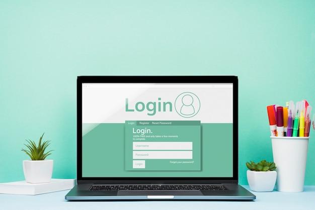Vooraanzicht mock-up laptop met blauwe achtergrond Gratis Psd