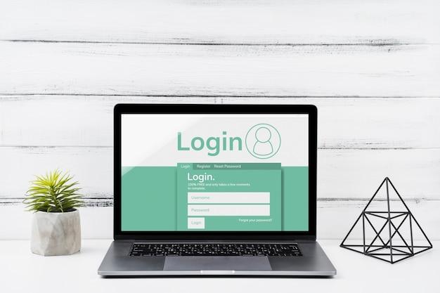 Vooraanzicht mock-up laptop met houten achtergrond Gratis Psd