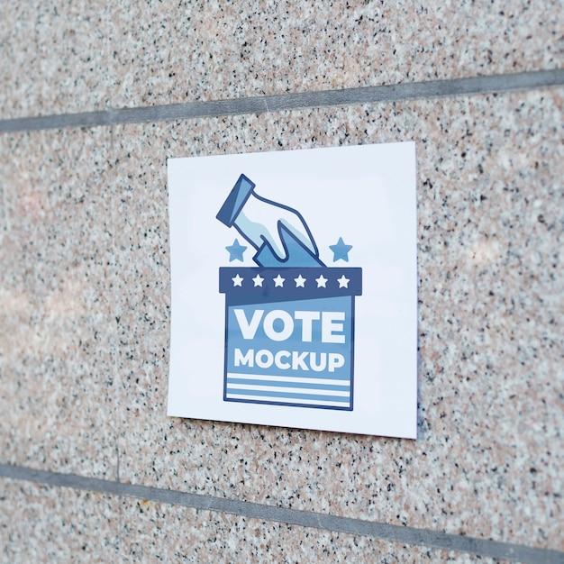 Vooraanzicht stembiljet mock-up op de muur Gratis Psd