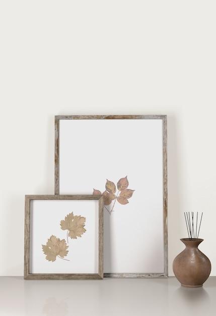 Vooraanzicht van decoratieve frames met vaas Gratis Psd