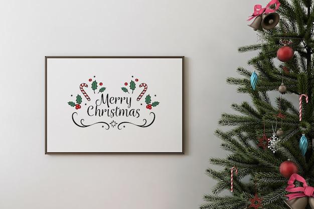 Vooraanzicht van mockup posterframe en kerstboom Premium Psd