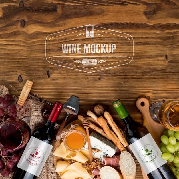 Vooraanzicht wijnflessen en vleeswarenbord met kopie-ruimte Gratis Psd