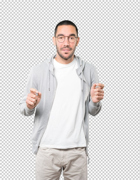 Vriendelijke jonge man doet een gebaar van bewondering Premium Psd