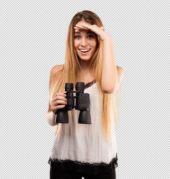 Vrij jonge vrouw die verrekijkers met behulp van Premium Psd