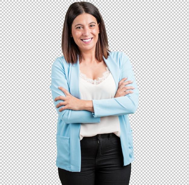 Vrouw van middelbare leeftijd kruising zijn armen, glimlachen en gelukkig, zelfverzekerd en vriendelijk Premium Psd