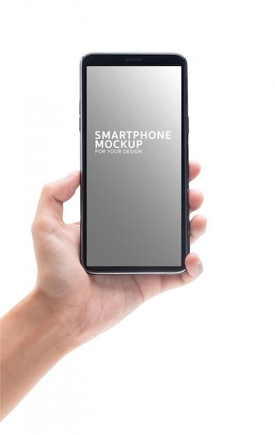 Vrouwenhand die het zwarte smartphonemodel voor uw ontwerp houden. Premium Psd