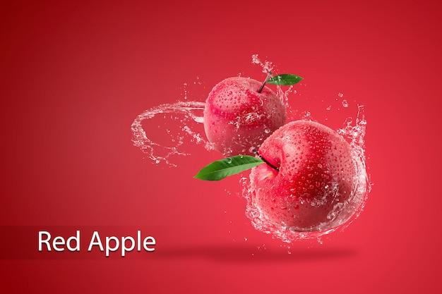 Water spatten op verse rode appel op rode achtergrond. Premium Psd