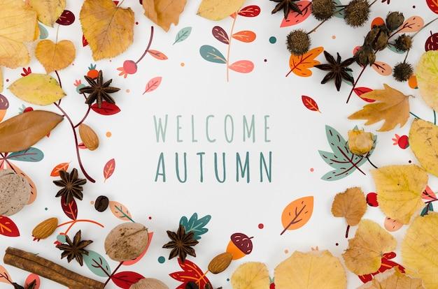 Welkom herfst belettering omringd door kleurrijke bladeren Gratis Psd
