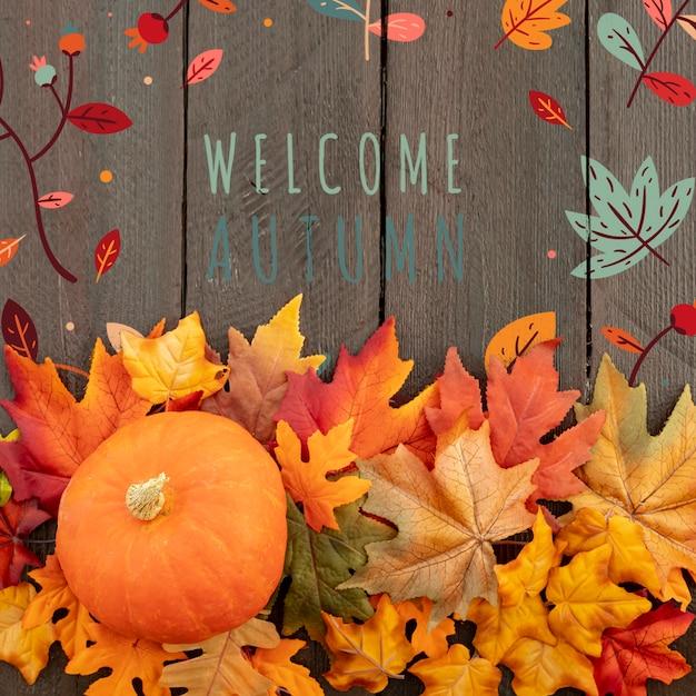 Welkom herfst met volwassen pompoen en bladeren Gratis Psd