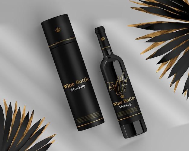 Wijnflessenmodel met ronde doos en palm Premium Psd