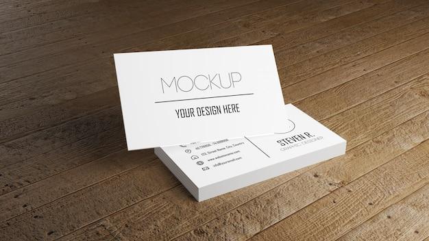 Wit adreskaartjemodel die op houten lijst stapelen. Premium Psd