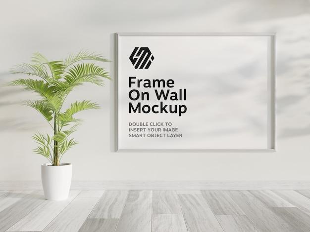 Wit frame opknoping op muur mockup Premium Psd