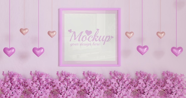 Wit vierkant kadermodel op roze muur met roze bladplanten en hartvormige hangende decoratie Premium Psd