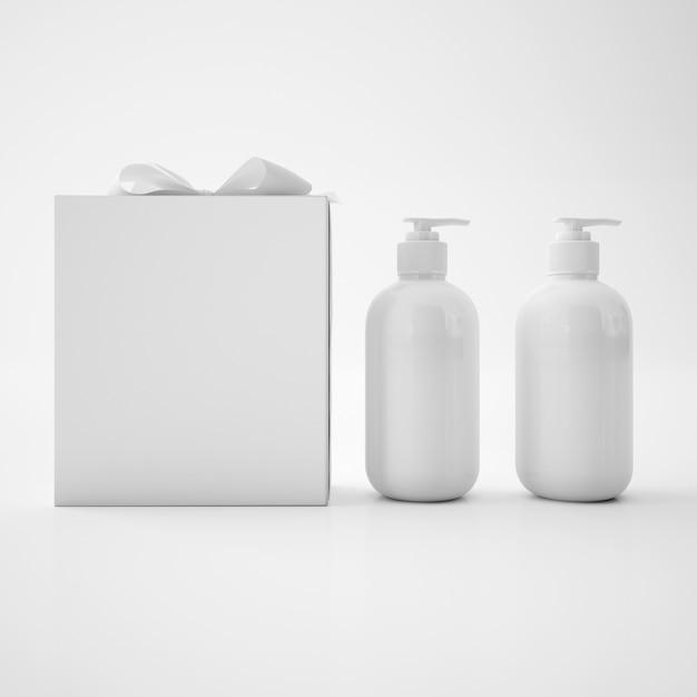 Witte zeepcontainers en witte doos met strik Gratis Psd