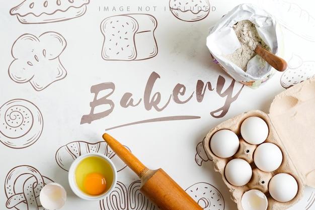 Zelfgemaakt bakken van vers brood en ander gebak van natuurlijke biologische ingrediënten op oppervlaktemodel Premium Psd