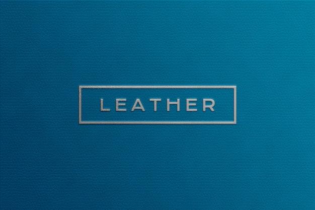 Zilveren logo mockup op blauw leer Premium Psd