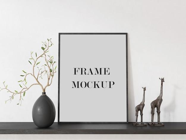 Zwarte fotolijst naast giraffen 3d-rendering mockup Premium Psd
