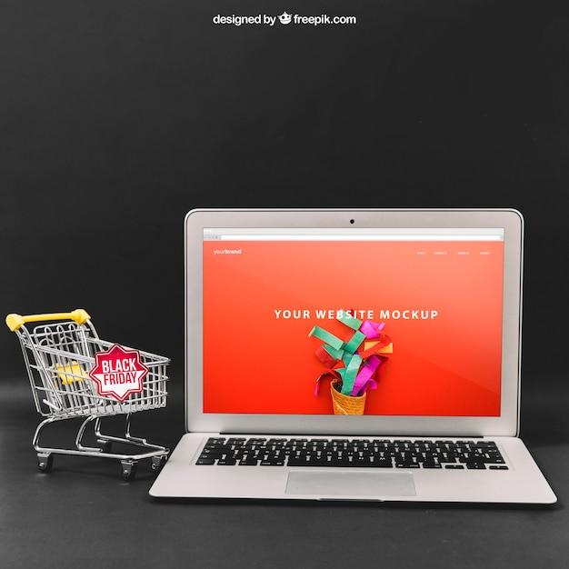 Zwarte vrijdag mockup met laptop Gratis Psd