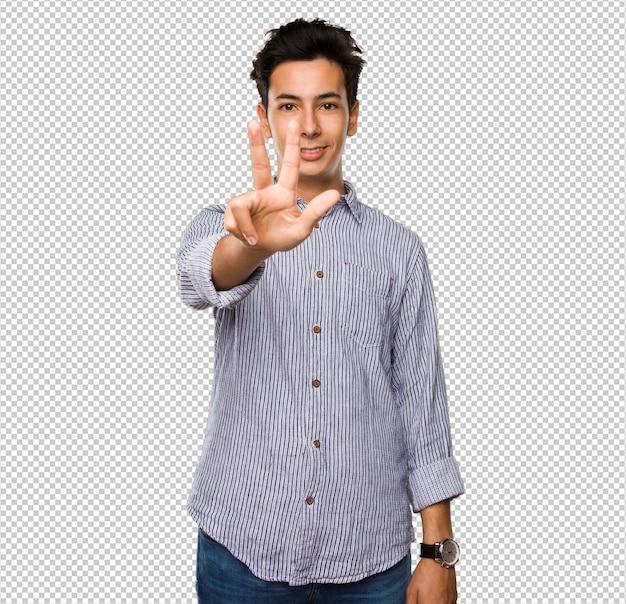 Adolescent faisant le geste numéro trois PSD Premium
