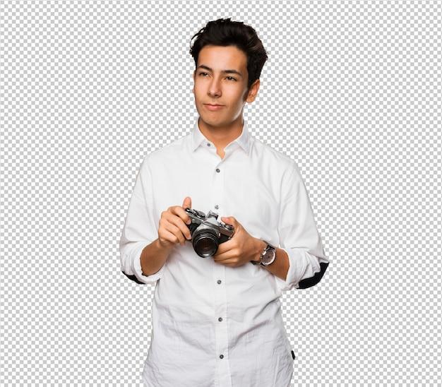 Adolescent, Prendre Des Photos Avec Un Appareil Photo Vintage PSD Premium