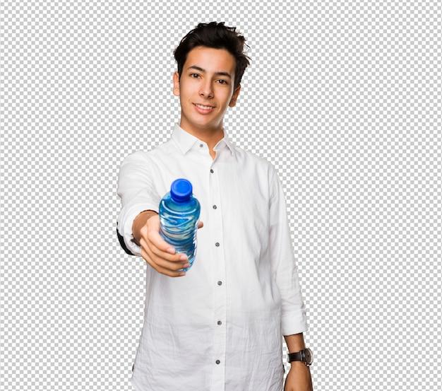 Adolescent tenant une bouteille d'eau PSD Premium