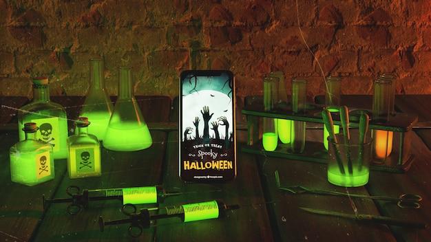 Arrangement D'halloween Effrayant Avec Smartphone Psd gratuit
