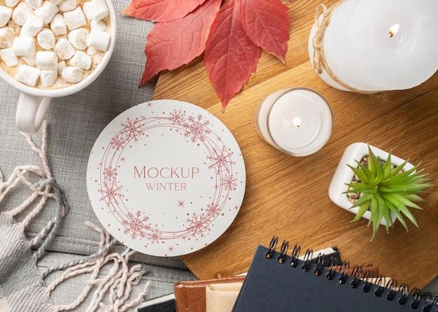 Arrangement Hygge D'hiver Avec Maquette De Plaque Psd gratuit