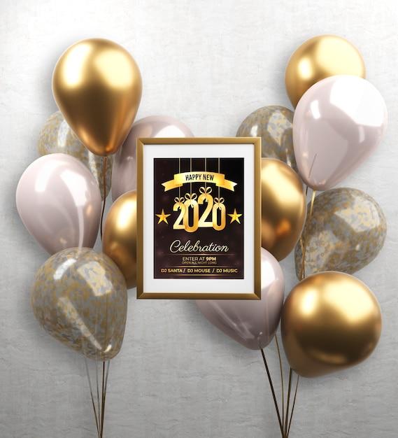 Ballons et cadre avec thème de la nouvelle année Psd gratuit