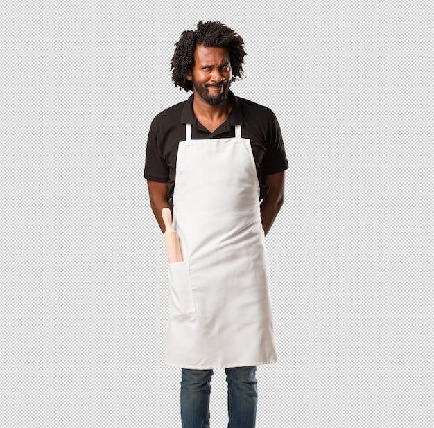 Beau Boulanger Afro-américain Doutant Et Confus, Pensant à Une Idée Ou Inquiet Pour Quelque Chose PSD Premium