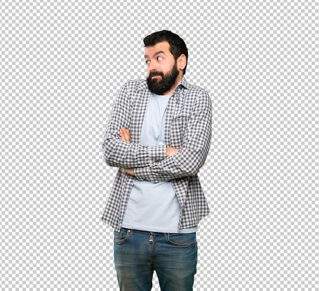 Bel homme à la barbe faisant des gestes douteux en soulevant les épaules PSD Premium
