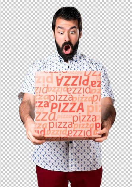 Bel homme brune à la barbe tenant une pizza PSD Premium