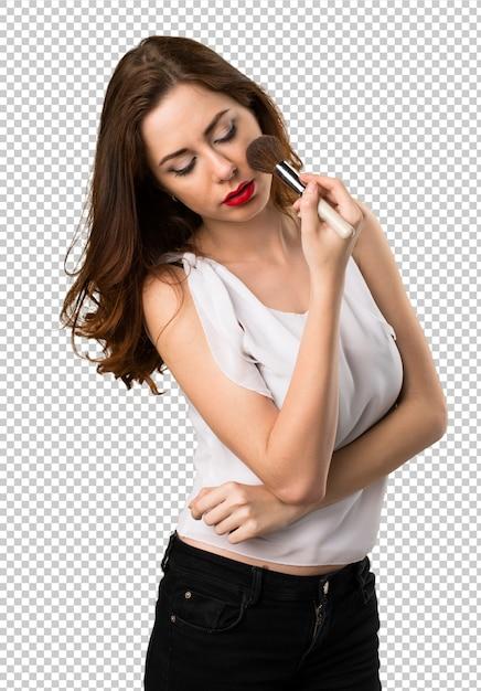 Belle jeune fille avec un pinceau de maquillage PSD Premium