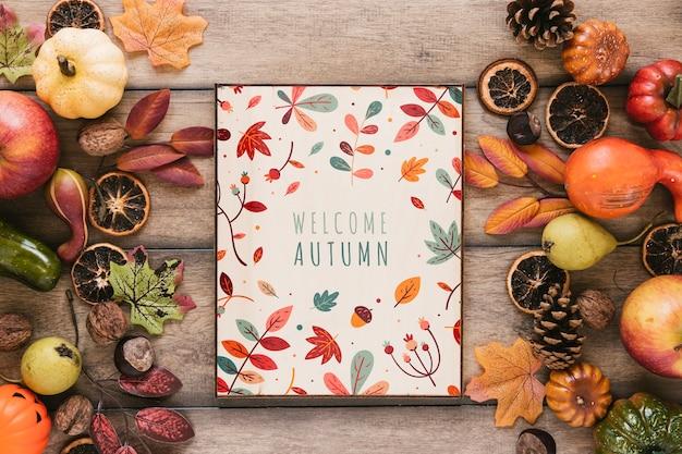 Bienvenue citation automne entouré d'éléments d'automne Psd gratuit
