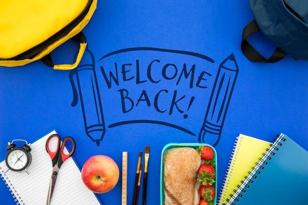 Bienvenue à l'école, sac à dos avec fournitures de l'élève Psd gratuit