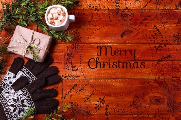 Boisson De Noël à Côté Du Cadeau Et Des Gants Psd gratuit