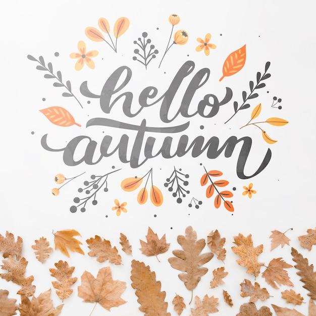 Bonjour citation automne avec des feuilles brunes Psd gratuit