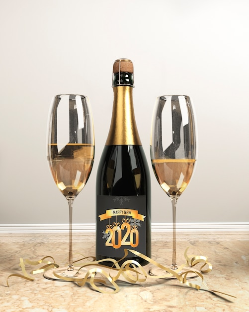 Bouteille de champagne et verres pour le nouvel an Psd gratuit