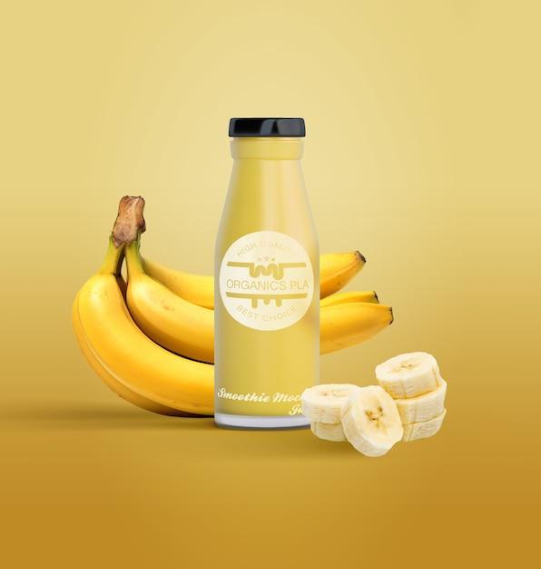 Bouteille isolée de jus de fruits et bananes Psd gratuit