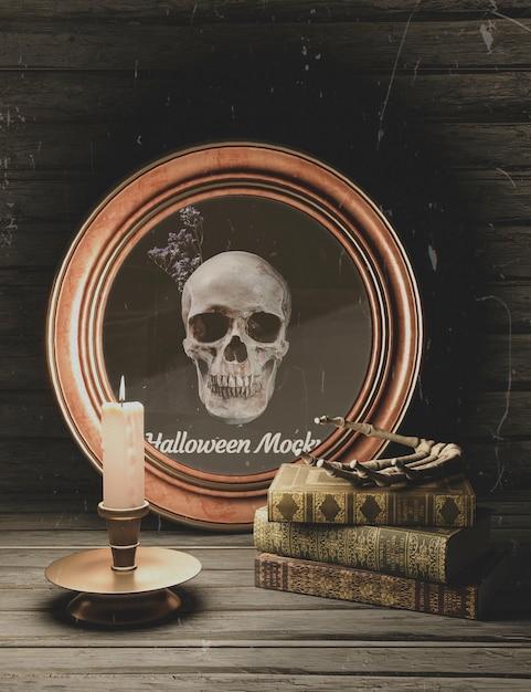Cadre rond halloween avec crâne et pile de livres Psd gratuit