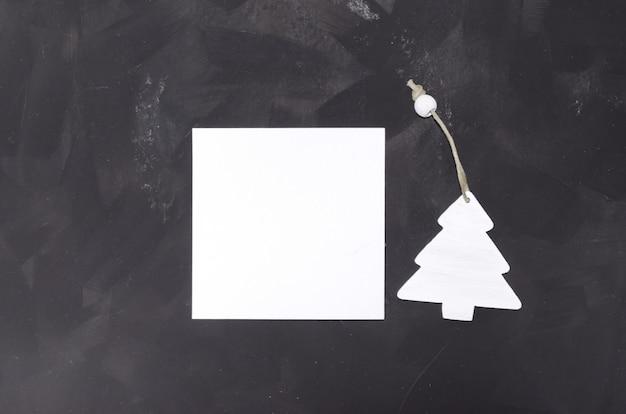 Carte Carrée De Maquette Minimaliste De Noël Sur Tableau Noir PSD Premium