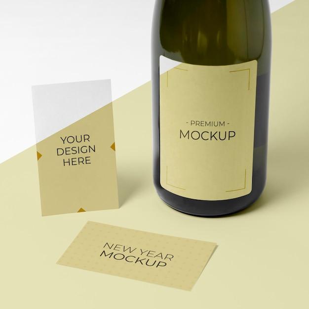 Carte De Visite De Vue De Haut De Maquette De Bouteille De Champagne Psd gratuit