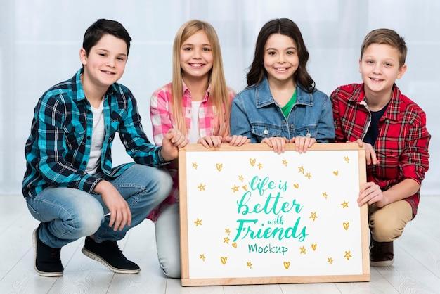 Communauté, Enfants, Tenue, Maquette, Signe, Ensemble Psd gratuit