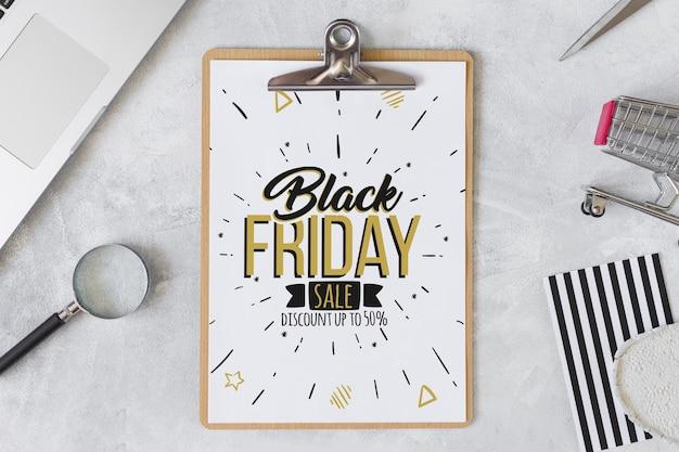 Composition du vendredi noir avec le presse-papiers Psd gratuit