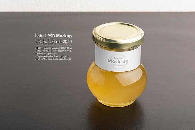 Confiture De Citron Dans Un Bocal En Verre Et Maquette D'étiquette Avec Capuchon Rond Sur Table Noire PSD Premium