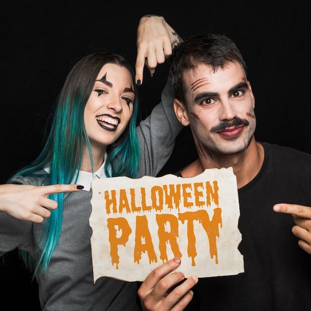 Couple, tenue, papier, halloween, lettrage Psd gratuit