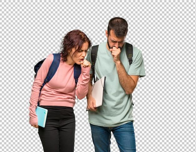 Deux étudiants avec des sacs à dos et des livres souffrent de toux et se sentent mal PSD Premium