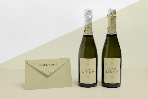 Enveloppe Vue De Face Et Maquette De Bouteilles De Champagne Psd gratuit